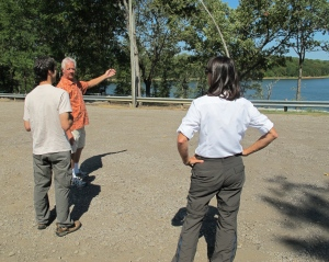 Harry visiting with Chuck Dovish at Lake Alma as trail volunteer,Laura Seal, looks on.