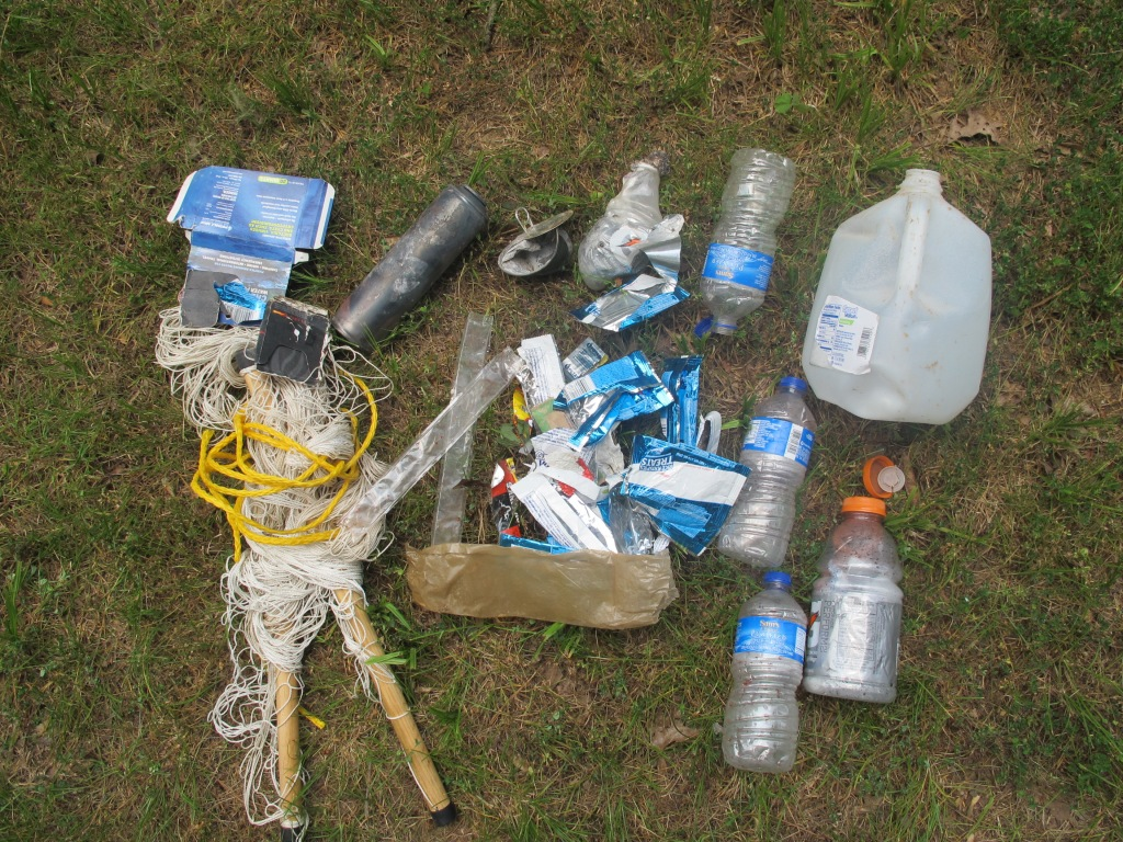Some of the trash collected at the site.  Notice the burned aerosol can.