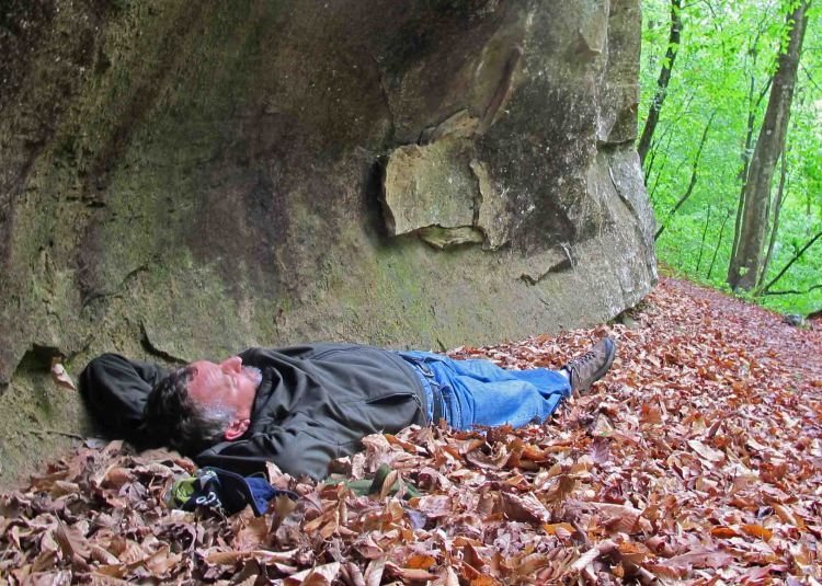 Napping under a bluff overhang.