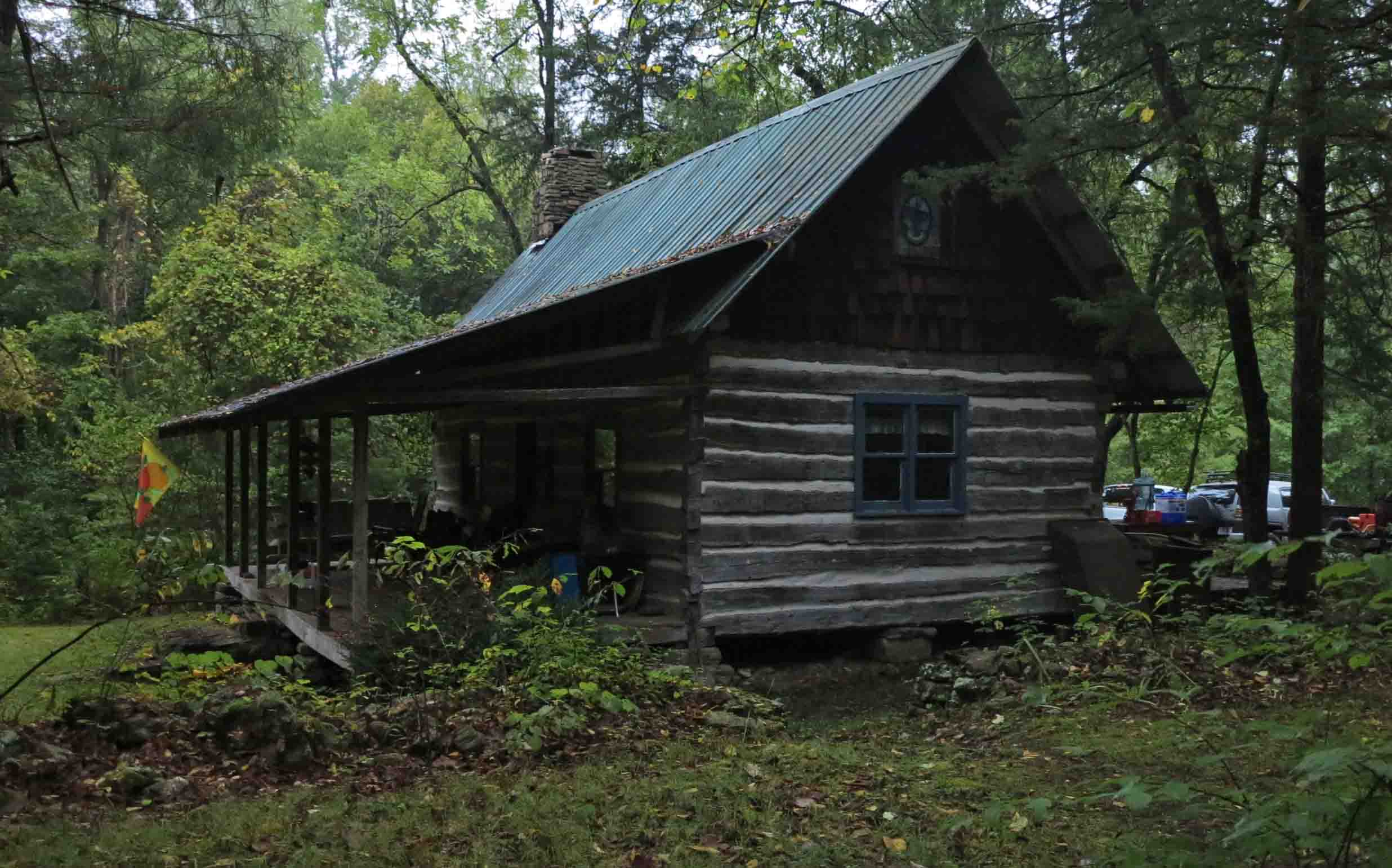 b arkansas church ozark photo sits country running the of cabins in foothill on mountains with grassy road gravel