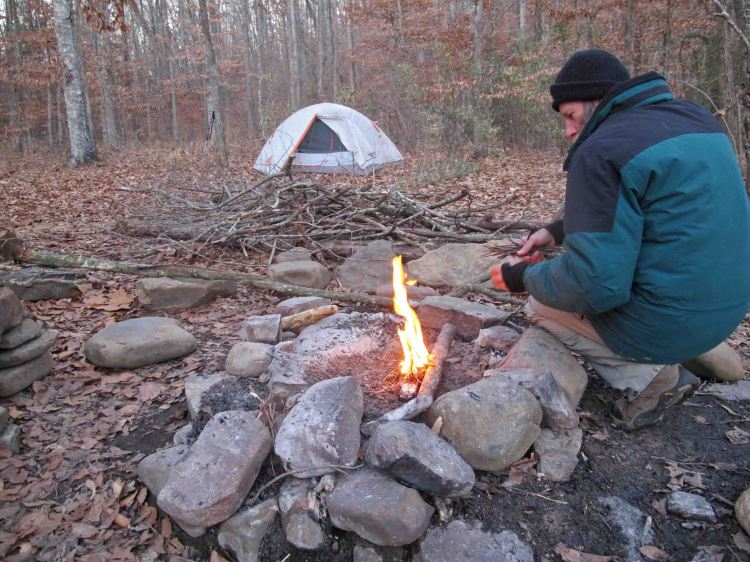 Bob building a fire at the west crossing of Hurricane Creek.
