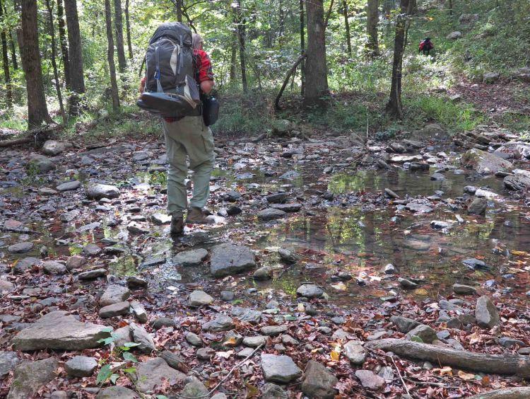 Bob stepping across Spirits Creek.