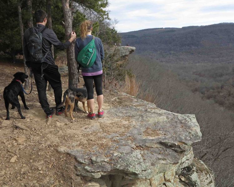 A couple looking at Hawksbill Crag in the distance.