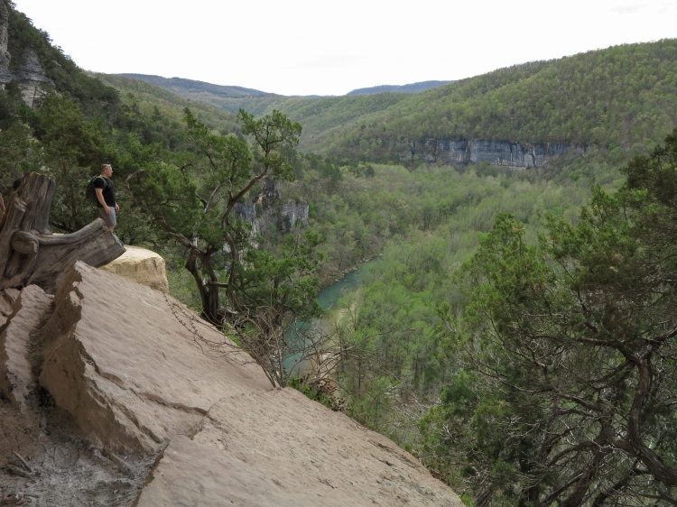 Hiker on Goat Bluff looking down on the Buffalo River