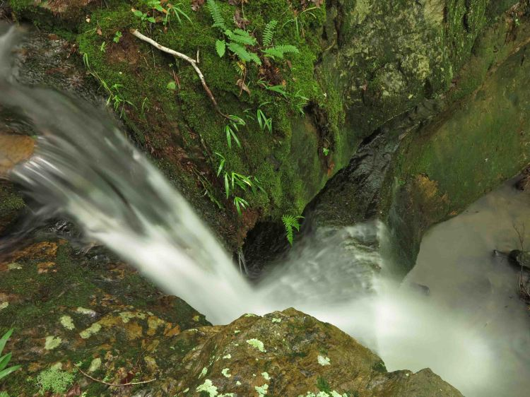 Stream flowing over the top of Marinoni Falls