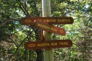 Signs clarify routes at trail intersections.